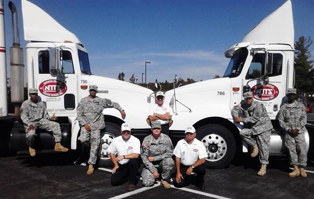 veterans lined up in front of NTTS trucks