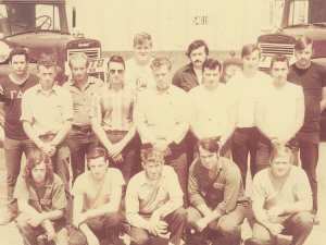 1972-1974 NTTS students posing in front of trucks