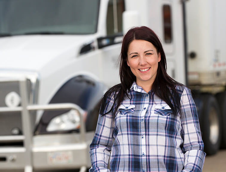 female standing in front of semi truck