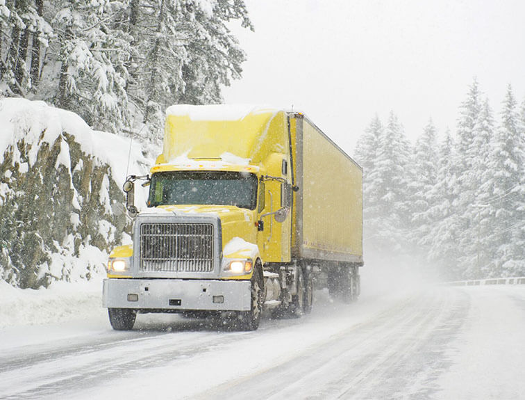 semi truck driving in the snow