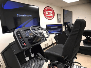 NTTS classroom featuring a virtual drivng simulator.